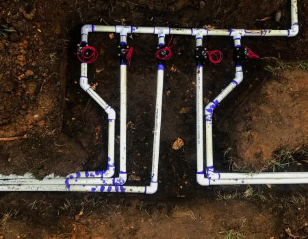 Underground irrigation manifold exposed